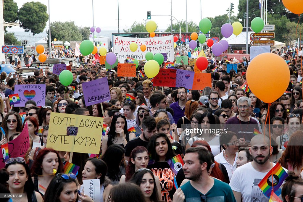 People parade in the streets of Thessaloniki, northern Greece, as they take part in the city's 5th Gay Pride march, on June 25, 2016