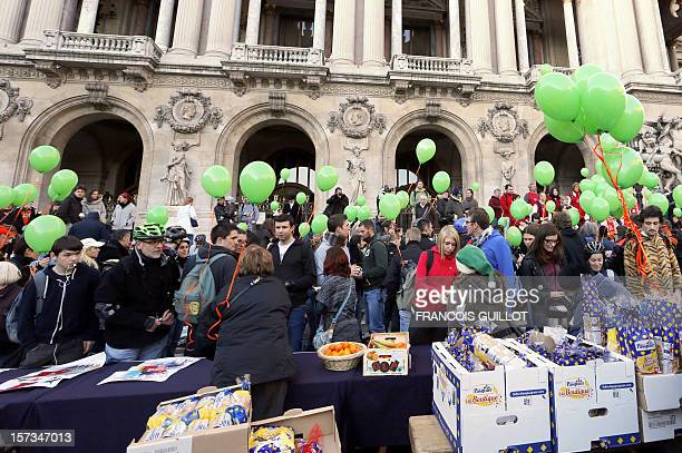 People parading in Paris' streets with rollerblades and green balloons make a stop on December 2 2012 in front of the Opera Garnier in Paris as part...