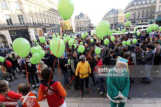 People parading in Paris' streets with rollerblades make a stop on December 2 2012 in front of the Opera Garnier in Paris as part of a campaign by...