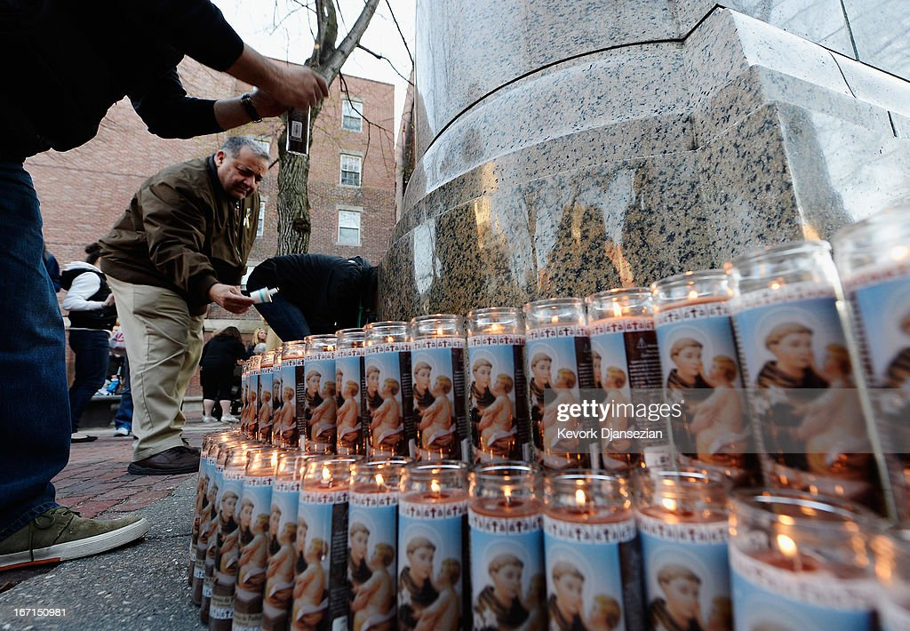 People participate in a candelight vigil for victims of Boston Marathon bombings on April 21, 2013 in Boston, Massachusetts. A manhunt for Dzhokhar A. Tsarnaev, 19, a suspect in the Boston Marathon bombing ended after he was apprehended on a boat parked on a residential property in Watertown, Massachusetts. His brother Tamerlan Tsarnaev, 26, the other suspect, was shot and killed after a car chase and shootout with police. The bombing, on April 15 at the finish line of the marathon, killed three people and wounded at least 170.