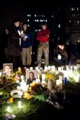 People participate in a candle light vigil at University Medical Center for US Rep Gabrielle Giffords who was shot during an event in front of a...