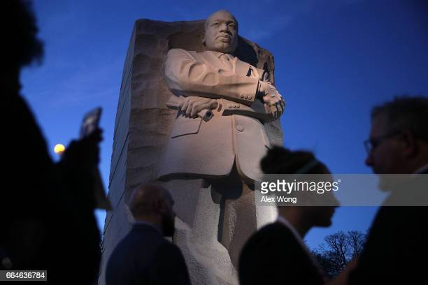 People participate in a candlelight vigil at the Martin Luther King Jr Memorial April 4 2017 in Washington DC The Memorial Foundation held its annual...