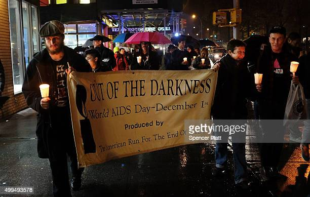 People participate in a candlelight vigil for World Aids Day on December 1 2015 in New York City Across the country activists politicians community...