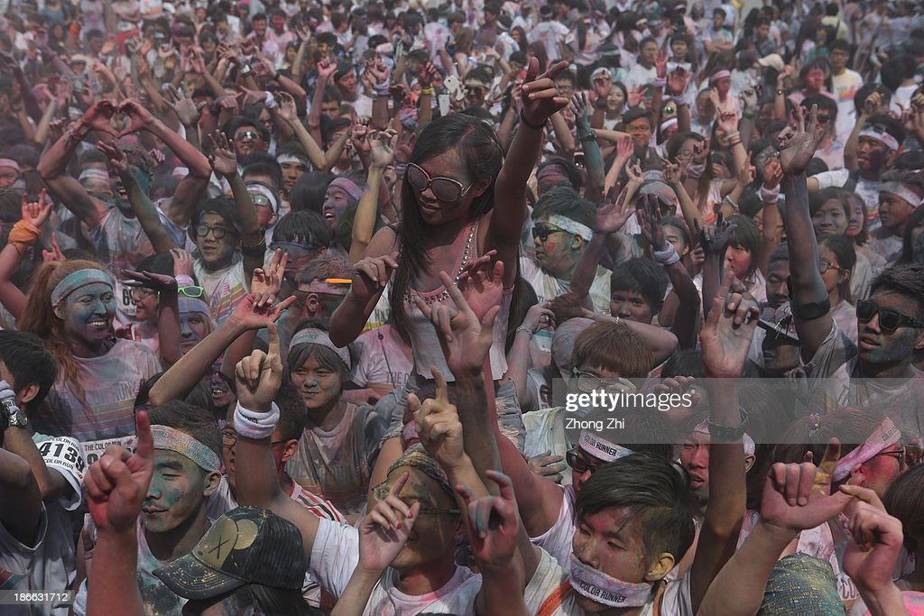 People participate in a Colour Run at the Guangzhou Olympic Center November 2, 2013 in Guangzhou, China. Thousands of people took part in the event.