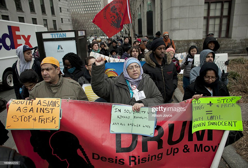People participate in a demonstration against the city's 'stop and frisk' searches in lower Manhattan near Federal Court March 18, 2013 in New York City. Hearings in a federal lawsuit filed by four black men against the city police department's 'stop and frisk' searches starts today in Manhattan Federal Court.