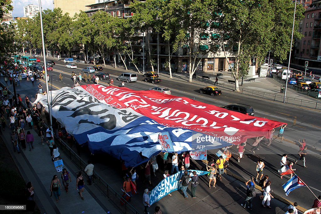 People participate in a march of the Peoples' Summit 'for Social Justice, International Solidarity and in Defence of the Commons', held in the sidelines of the weekend's CELAC-EU Summit, in downtown Santiago on January 25, 2013. More than 40 Heads of State and Government of the Community of Latin American and Caribbean States (CELAC) and the European Union (EU) will meet on January 26 and 27 to promote a strategic partnership between the two regions. AFP PHOTO/RODRIGO SAENZ