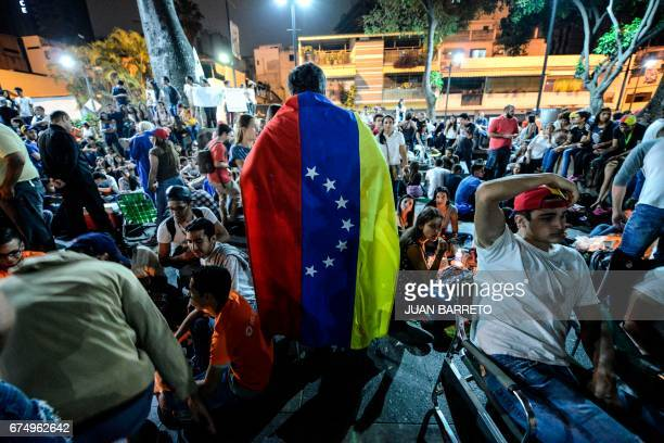 TOPSHOT People participate in a march paying tribute to student Juan Pablo Pernalete killed on April 26 by the impact of a gas grenade during a...