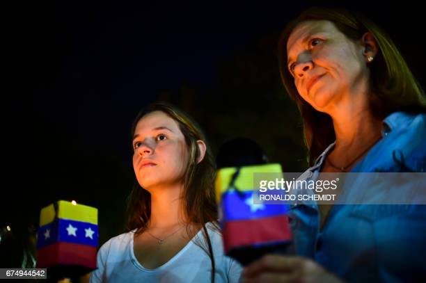TOPSHOT People participate in a march paying tribute to Venezuelan student Juan Pablo Pernalete killed on April 26 by the impact of a gas grenade...