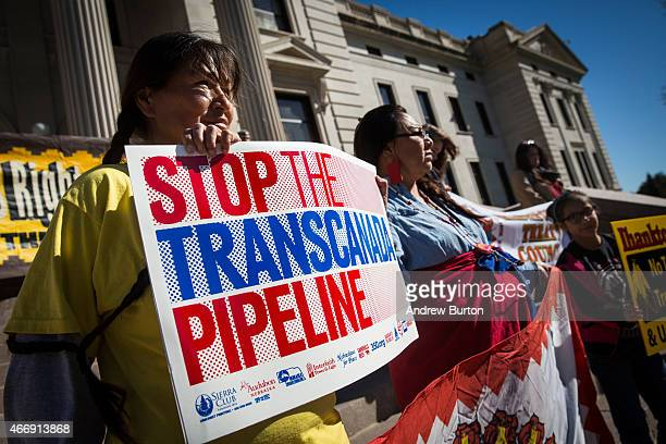 People participate in a protest against the proposed Keystone XL pipeline on October 13 2014 in Pierre South Dakota Numerous Native American tribes...