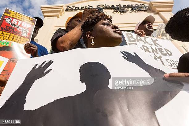 People participate in a rally to protest the death of Walter Scott who was killed by police in a shooting outside City Hall on April 8 2015 in North...