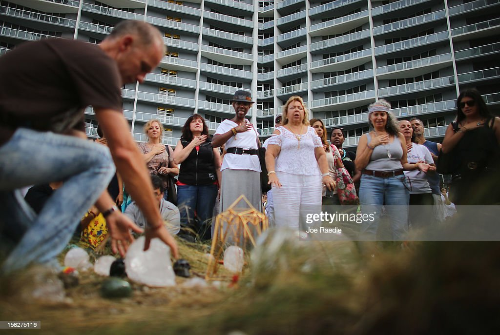 People participate in a sacred 12.12.12 ceremony with ancient crystal skulls at Miami Circle which is a Tequesta indian site used centuries ago on December 12, 2012 in Miami, United States. The ceremony was held on the calender date of 12-12-12 which is the last major numerical date using the Gregorian or Christian calendar for almost another century.