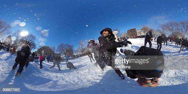 People participate in a snowball fight at Dupont Circle January 24 2016 in Washington DC The blizzard that has brought massive snowfall and a...