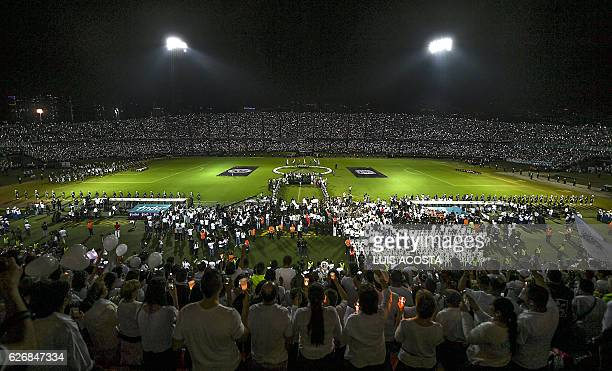 People participate in a tribute to the players of Brazilian team Chapecoense Real killed in a plane crash in the Colombian mountains on November 30...