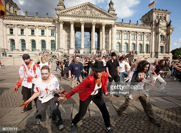 People participate in a zombie/ Michale Jackson Tribute flashmob in front of the Reichstag on August 29 2009 in Berlin Germany