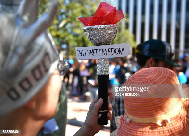 People participate in Tech Stands Up rally against President Donald Trump in Palo Alto California on March 14 2017 / AFP PHOTO / Josh Edelson