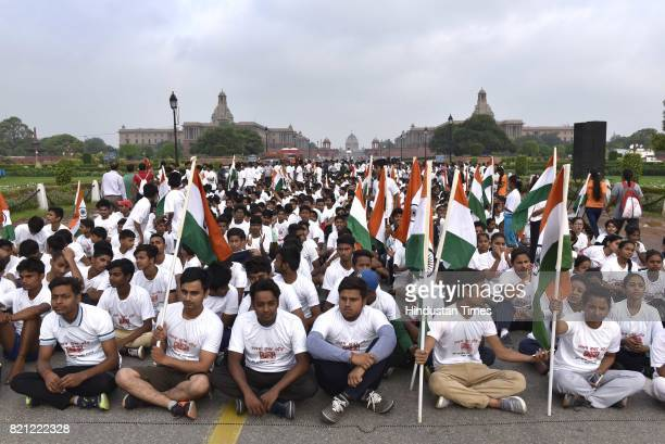 People participate in the 11th Slum Yuva Run flagged off by Union Sports Minister Vijay Goel at Rajpath on July 23 2017 in New Delhi India