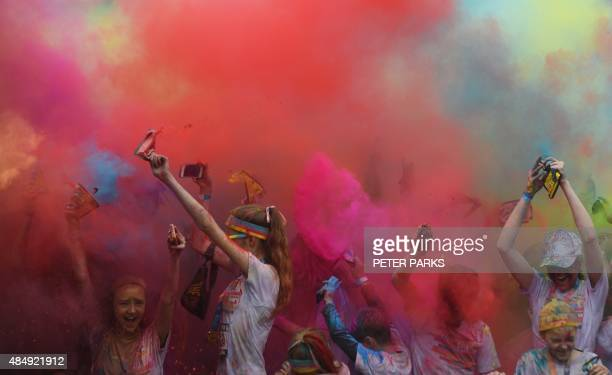 People participate in the annual Color Run after party in Centennial Park in Sydney on August 23 2015 The Color Run is a 5km fun run started in the...
