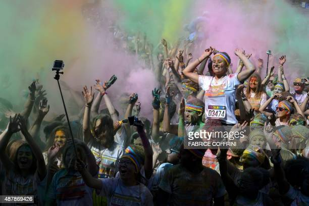 People participate in the annual Color Run after party on September 12 2015 in Lausanne The Color Run is a 5km fun run started in the US in 2012 and...