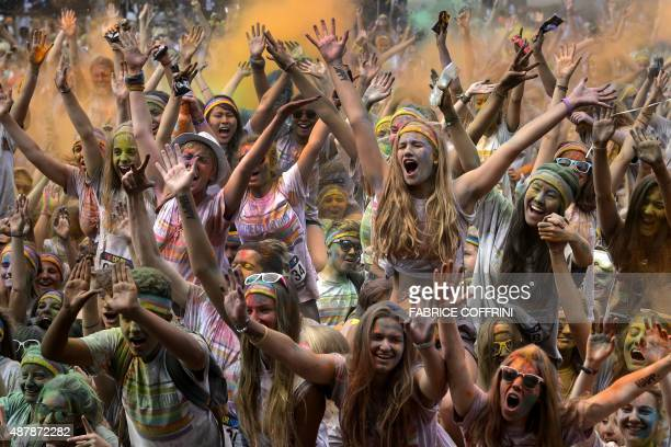 People participate in the annual Color Run after party on September 12 2015 in Lausanne The Color Run is a 5km run that started in the US in 2012 and...