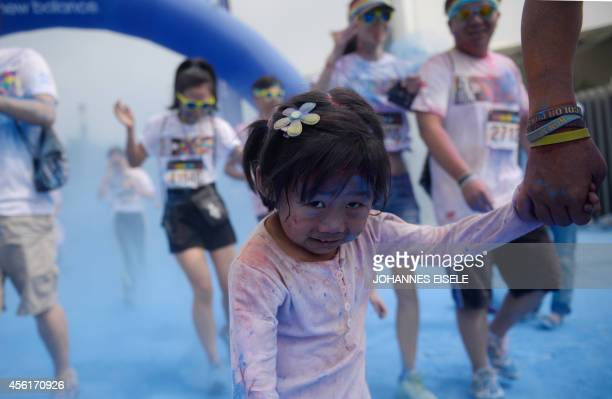People participate in the annual Color Run in Shanghai on September 27 2014 The Color Run is a five kilometre race without winners where participants...