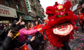 People participate in the Chinese New Year Parade on February 2 2014 in the Chinatown neighborhood of New York City The parade which is in it's 15th...