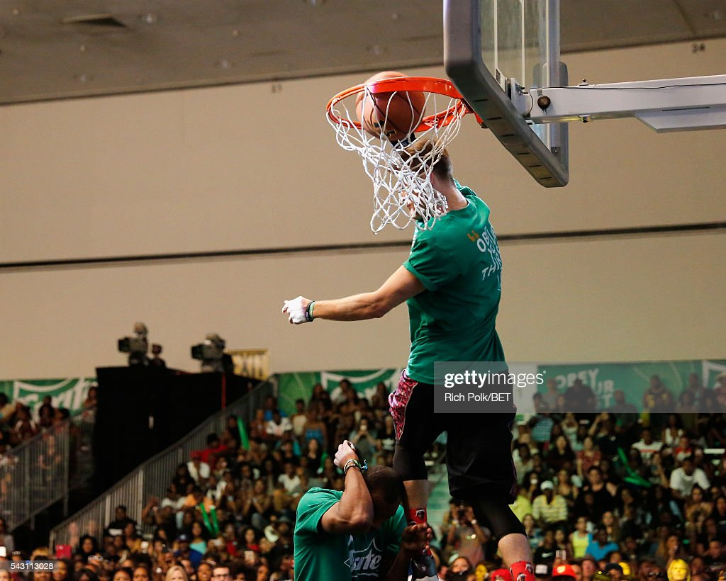 People participate in the slam dunk contest during the 2016 BET Experience on June 25, 2016 in Los Angeles, California.