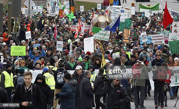 People participate in the The 100% Possible Climate March in Ottawa on November 29 2015 Some 150 leaders including US President Barack Obama China's...