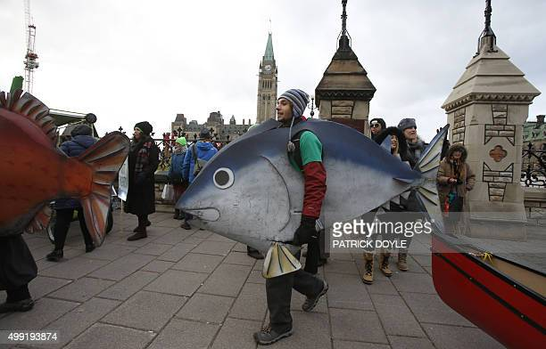 People participate in the The 100% Possible Climate March on Parliament Hill in Ottawa on November 29 2015 Some 150 leaders including US President...