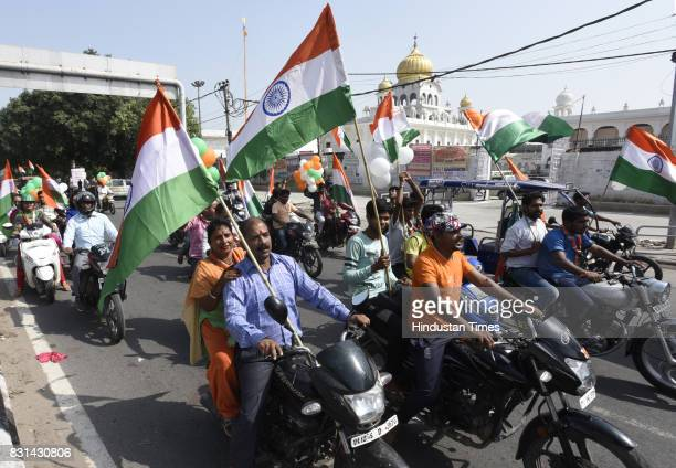 People participate in Tiranga Yatra to celebrate the 71st Independence Day on August 14 2017 in New Delhi India The march started from Lal Bagh and...