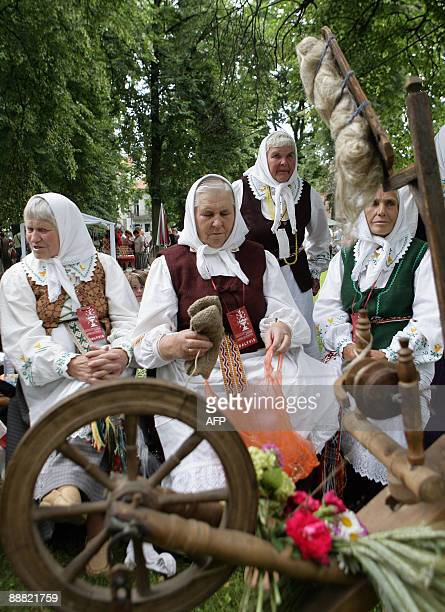 People participate on Folklore Day in Sereikiskiu Parkas in Vilnius on July 4 2009 during the Millenium Song Celebration Festival of Lithuania In...