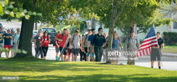 People participating in a 94mile hike from the University of Maine Portland campus to its Gorham campus walk along Main Street in Westbrook on Monday...