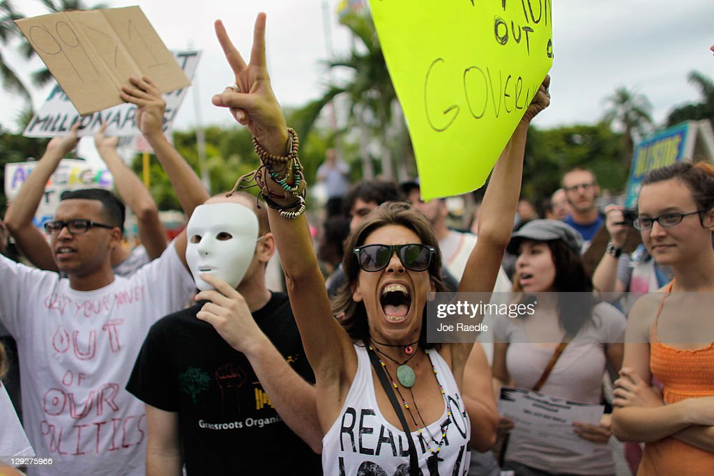 People particpate in an Occupy Miami protest on October 15 2011 in Miami Florida Thousands of people are taking to the streets in cities across the...