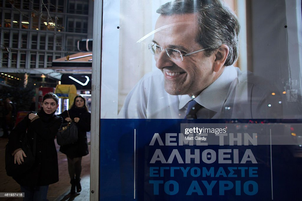 People pass a election poster of Greece's Prime Minister and ruling conservative New Democracy party leader Antonis Samaras ahead of this weekend's general election on January 21, 2015 in Athens, Greece. According to the latest opinion polls, the left-wing Syriza party are poised to defeat Prime Minister Antonis Samaras' conservative New Democracy party in the election, which will take place on Sunday. European leaders fear that Greece could abandon the Euro, write off some of its national debt and put an end to the country's austerity by renogotiating the terms of its bailout if the radical Syriza party comes to power. Greece's potential withdrawal from the eurozone has become known as the 'Grexit'.