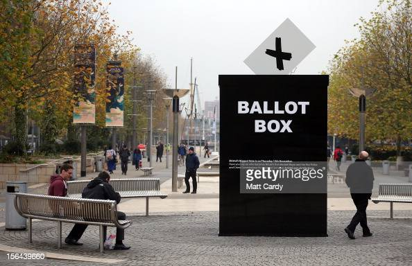 People pass a mock ballot box erected to encourage people to vote in the Bristol mayoral election on November 15 2012 in Bristol England Although...