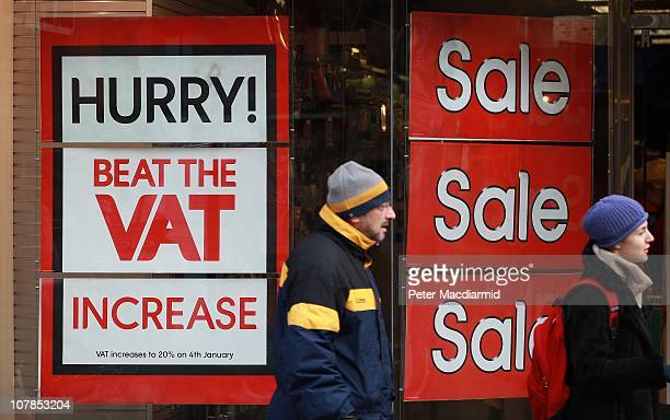 People pass a shop advertising a sale to beat the VAT increase in Camden on January 3 2011 in London England Value Added Tax increases by 25 % to 20...