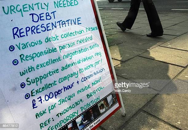 People pass a vacancy sign looking for debt collectors outside a recruitment job shop on March 18 2009 in Bristol England Official figures published...