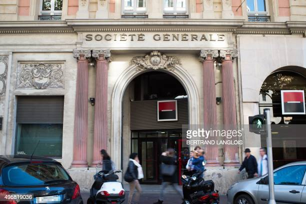 People pass by a branch of the Societe Generale bank in Marseille southern France on November 5 2015 Societe Generale bank which also owns Credit du...