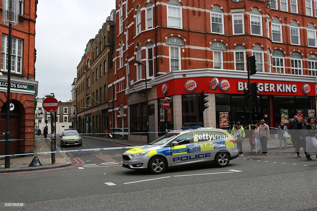 People pass by a cordon off section of Camden High street as a murder investigation is underway in Camden on May 29, 2016 in London, England. Reportedly a stabbing took place in the area leaving one man dead after being taken to the hospital.