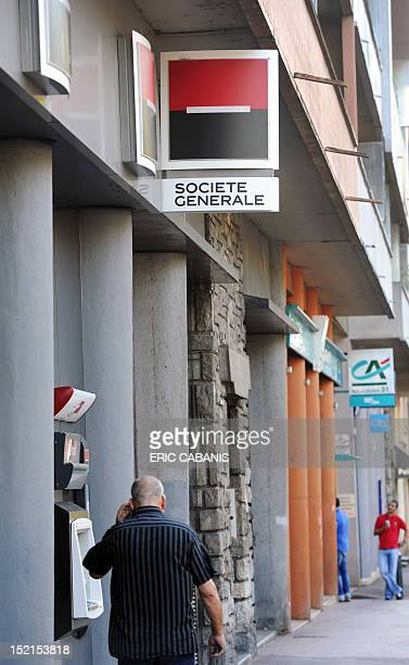 People pass by agencies of French banks Societe Generale and Credit Agricole on September 12 2011 in Toulouse southwestern France Shares in French...