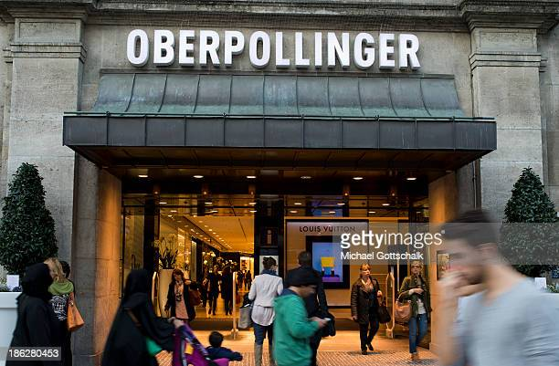 People pass by at Luxury Department Store Oberpollinger on October 28 2013 in Munich Germany