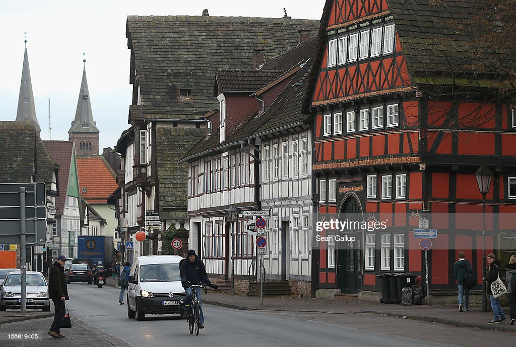 People pass by half-timbered houses on November 19, 2012 in Hoexter, Germany. Hoexter lies along the 'Fairy Tale Road' (in German: Die Maerchenstrasse) that leads through the region between Frankfurt and Bremen where the Grimm brothers collected and adapted most of their fairy tales, which include such global classics as Sleeping Beauty, Little Red Riding Hood, Rapunzel, Cinderella and Hansel and Gretel, in the early 19th century. The 200th anniversary of the first publication of the stories will take place this coming December 20th.