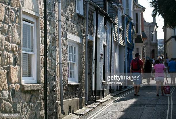 People pass by properties on August 4 2014 in St Ives Cornwall England A recent survey by the online hotel booking website cheaproomscouk has ranked...