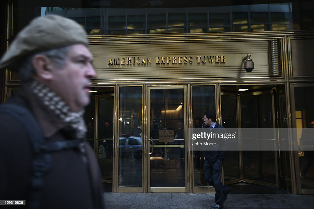 People pass by the American Express Tower at the World Financial Center on January 11, 2013 in New York, New York. Following low fourth quarter earnings, American Express announced plans to cut 5,400 jobs in the coming year.