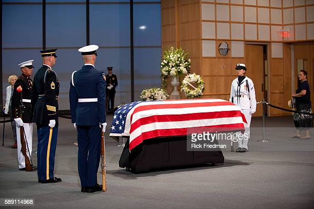 People pass by the casket containing the body of Senator Edward M Kennedy lying in repose at the John F Kennedy Library in the Dorchester section of...