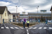 People pass by the entrance of Aperam stainless steel factory controlled by the Mittal family on December 24 2012 in Gueugnon central France where a...