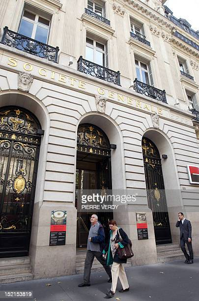 People pass by the headquarters of French bank Societe Generale on September 12 2011 in Paris The French stock market plunged by 427 percent in early...