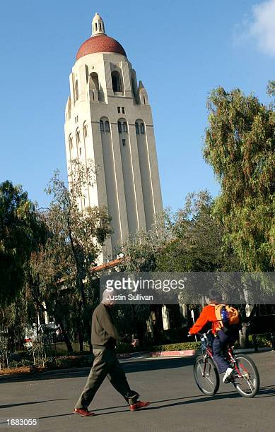 People pass by the Hoover Tower on the Stanford University campus December 11 2002 in Stanford California Stanford announced plans December 10 2002...