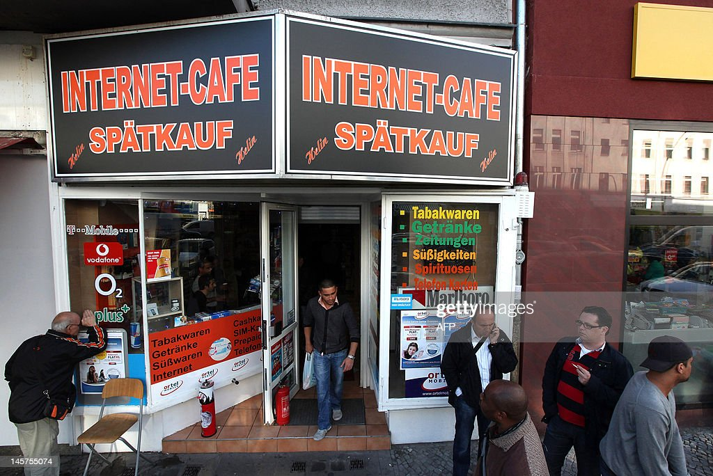 People pass by the Internet Cafe in the Neukoelln district of Berlin on June 4 2012 where Luka Rocco Magnotta dubbed the 'Canadian Psycho' who is...
