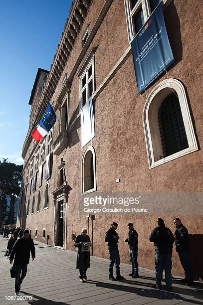 People pass by the Piazza Venezia beneath Italian and European Union flags flying from the balcony from which former Italian dictator Benito...