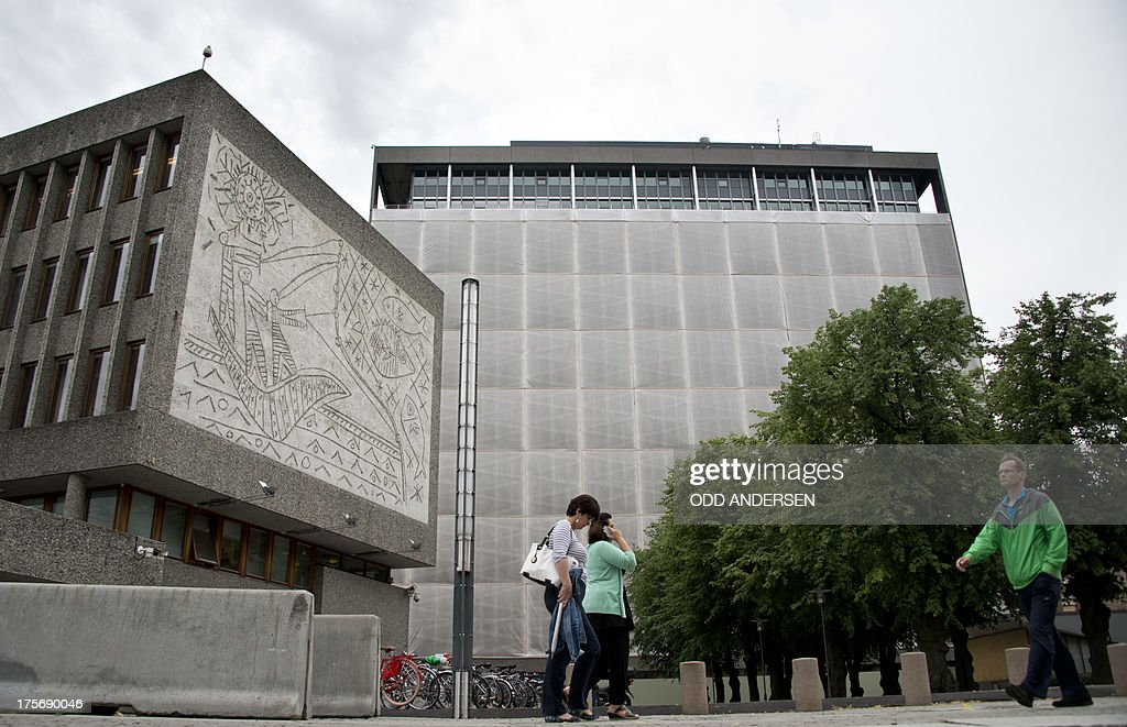 People pass Picasso's mural art work 'The Fisherman' (L) on the government quarter's 'Y building' in Oslo, Norway on August 6, 2013. The art work survived the 22nd July 2011 bombing unscathed, but other government buildings bearing the artist's murals were severely damaged. The Norwegian Directorate for Cultural Heritage fears that Picasso's first monumental concrete murals, which were made between the late 1950s and the early 1970s for two government buildings in Oslo, may be destroyed. The buildings were severely damaged during the deadly terrorist attack in the Norwegian capital in July 2011. The government is now considering whether to demolish the Modernist buildings that form the regjeringskvartal or government quarter.